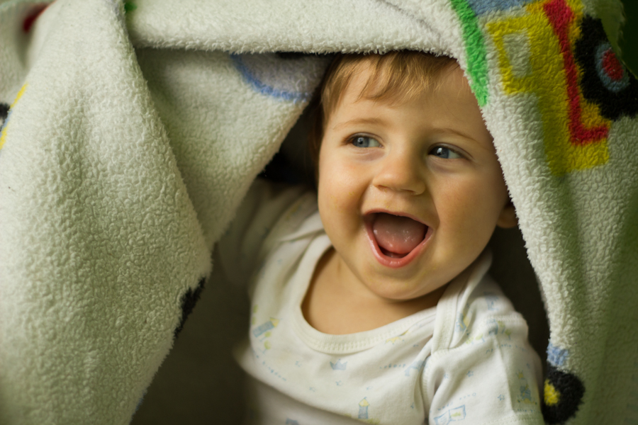happy-baby-under-blanket